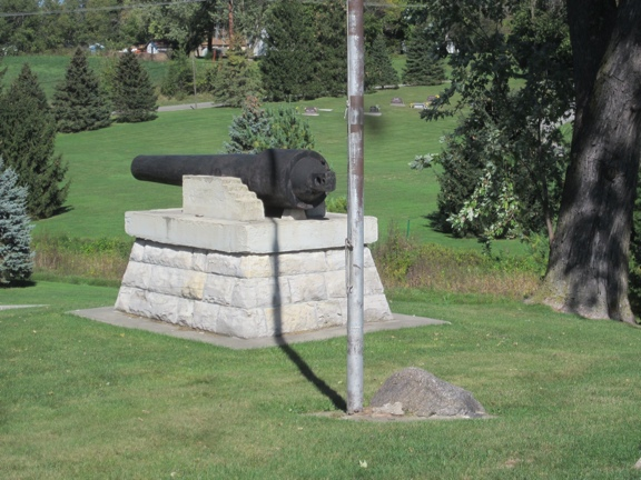 Cannon and Plaque in Cemetery